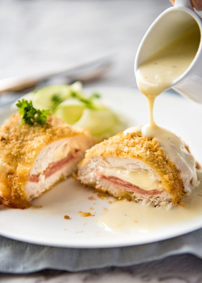 Easy Chicken Cordon Bleu - You are going to be amazed how easy it is to make this chicken stuffed with cheese and ham, coated in crunchy breadcrumbs and served with a gorgeous cheese sauce! www.recipetineats.com