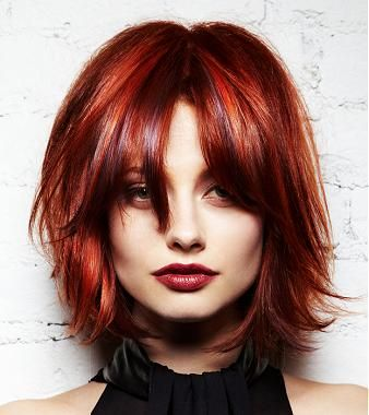 A Medium Red straight coloured multi-tonal glamourous womens choppy haircut hairstyle by L'anza