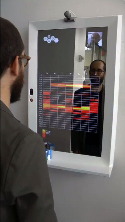 The 'reveal' mirror displays health data when a person stands in front of it. Just a concept right now, but very cool! Moooore data!