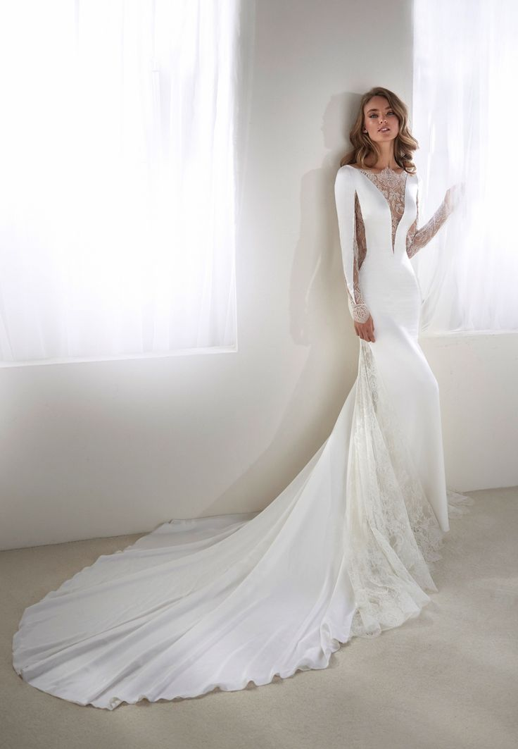 Combining a modern aesthetic with romantic details, the latest Atelier   Pronovias bridal collection is just too beautiful. *Want more? Here are nine   foolproof wedding dress shopping tips and six things to do before you put on   your wedding dress*