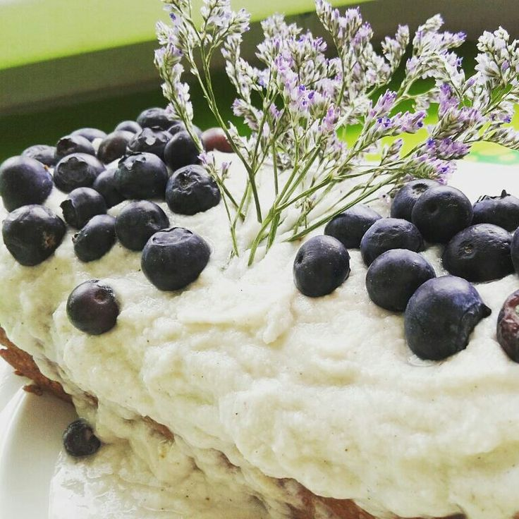Vegan carrot-banana bread with coconut cream and blueberries