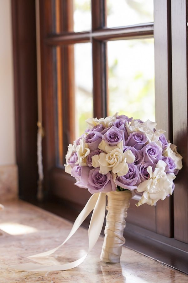 Gardenias and lavender roses double stain wrapped. What a lucky bride!