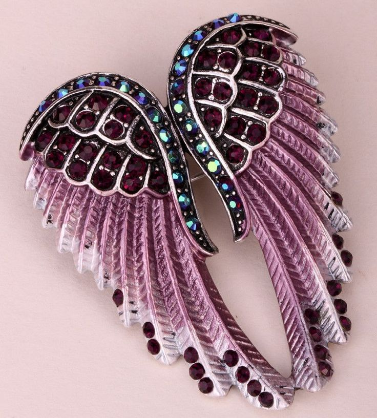 Item specifics Brand Name:wcl Item Type:Brooches Fine or Fashion:Fashion Shape\pattern:Feather Material:Crystal Style:Hiphop/Rock Metals Type:Zinc Alloy Gender:Women Brooches Type:Brooches Length:5cm
