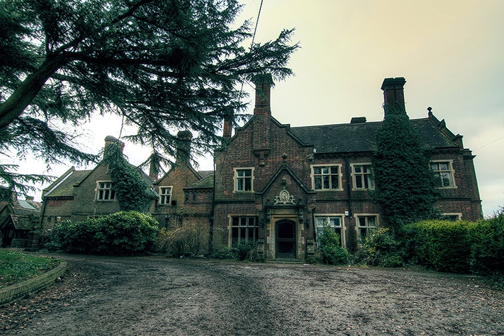 English abandoned mansion, made of brick, with beautiful but damaged interior, fireplaces, wooden staircases, etc.