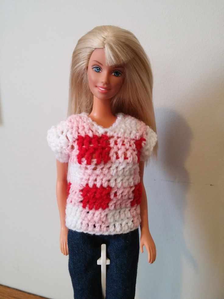 As promised, here is another pattern to get your Barbie ready for Valentines Day. Today's offering is a cute little plaid sweater with a v neck and short, scalloped edge sleeves. This pattern came about when I was messing around with the plaid technique one evening and it somehow turned into a doll sweater. I will warn you though, all those color changes in such a small space can be a bit fiddly! One note about finishing off the ends. [Read more]