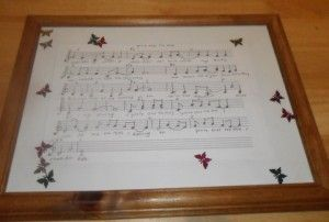 """Words to """"our wedding song"""" hand printed and framed as an anniversary gift to a husband.  Sentimental but manly.  Excellent idea."""