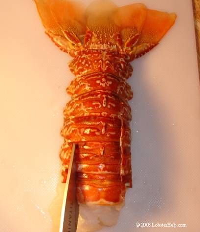 Where I learned how to butterfly a lobster tail... the shells are VERY sharp.  Hope the broiling instructions work well...
