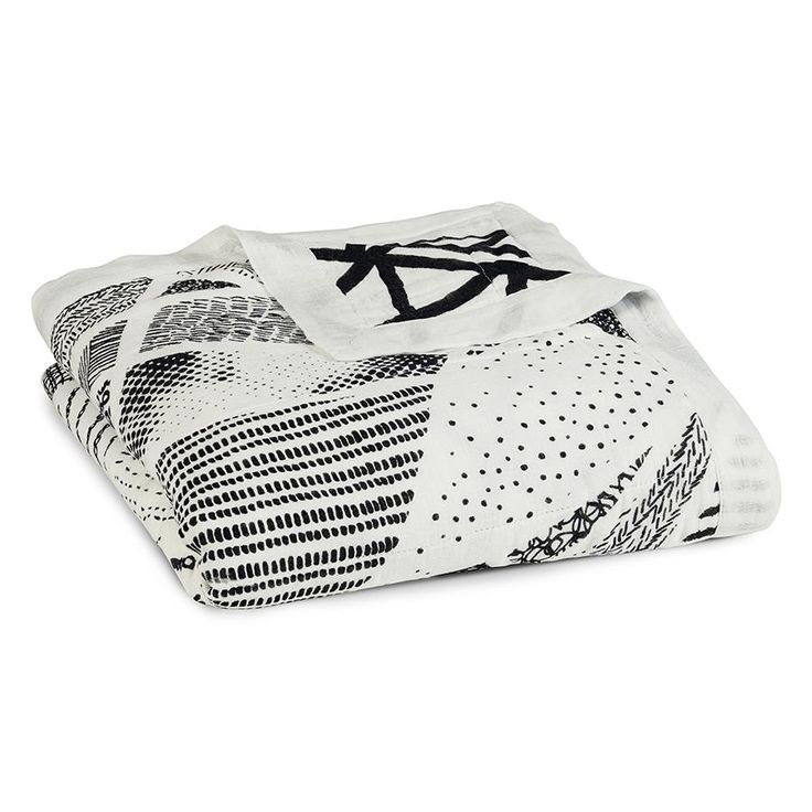 Bold, graphic black + white prints make these baby dream blankets fit in with any nursery decor and the silky soft muslin feel will keep baby oh-so comfortable.