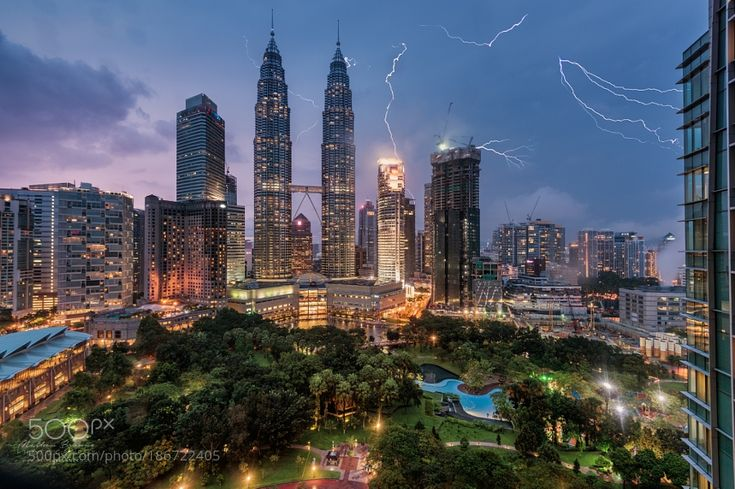 http://500px.com/photo/186722405 Lightning over the Petronas Towers by MathewBrowne -http://instagram.com/mathewbrowne http://facebook.com/mathewbrownephotography  Taken from the 20th floor of the Traders Hotel in Kuala Lumpur on a stormy early evening. The Petronas Towers and surrounding buildings are struck by several bolts of lightning. This is a composite of 4 exposures taken within the space of 2 minutes. The lightning was striking every few seconds but those were the only shots I was…