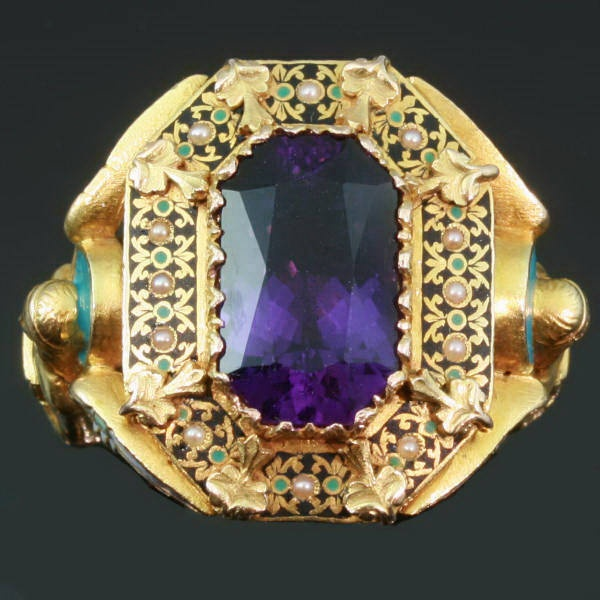Hidden inside this Bishop's ring (1869) we found a silver ring with a relief of a gold wolf. Bishops rings are normally worn on gloves so their size is larger then normal. It is set with an amethyst and has elaborate enameled angels on both sides. Each angel holds a shield, one shield with the Chi Rho sign and the other shield with PSV, the Bishop's initials.