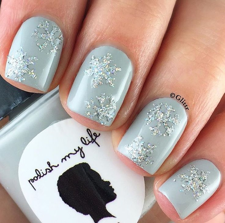 ❄️Lovely snowflake manicure by @glittr using our Snowflake Nail Decals found at snailvinyls.com