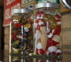 I might have to do something like this in the basement. Buy hurricanes (not these ugly jars) and fill with lures, bobbers, etc. Put on mantle.