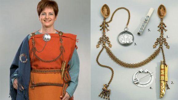 Dress and replica jewelry from Kalevala Koru.