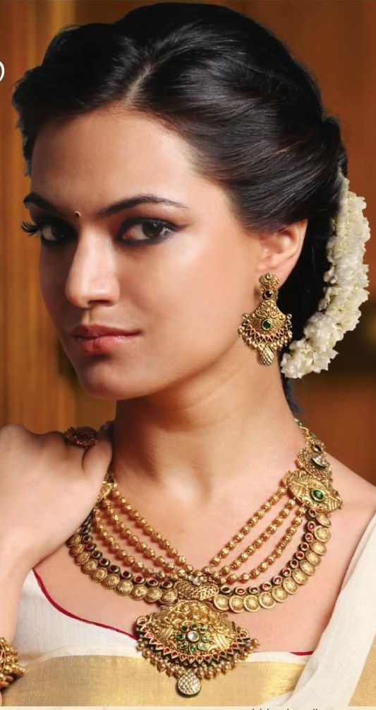Indian Wedding Hairstyle - Classic Indian Bun With Flower Embellishment