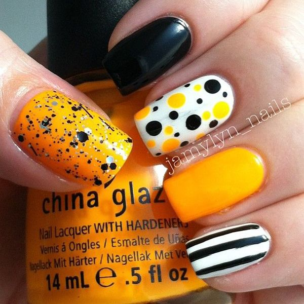 Halloween color themed nail art design. Play along with Halloween shades and create abstract designs such as polka dots and stripes to add attitude to your nails this Halloween.
