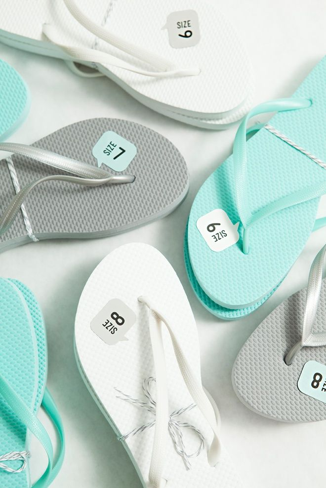 Rather than just placing flip flops in a basket for guests to grab at your wedding, add sizing to them for ease.