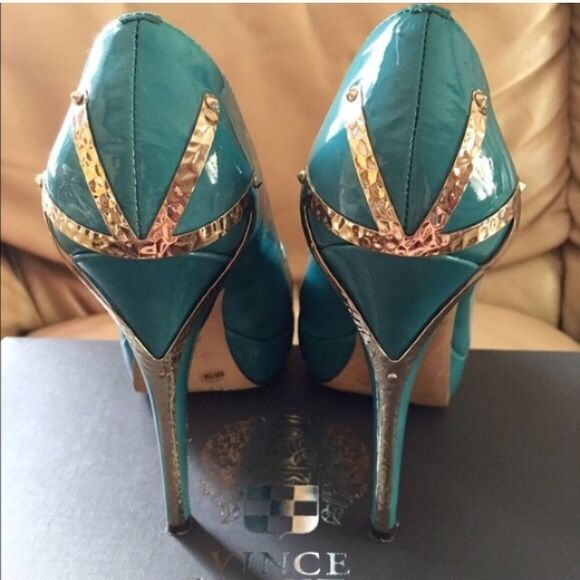 Vince Camuto Turquoise Heels  Turquoise Heels with Emblem on the back. Willing to negotiate big time since these DO NOT fit me!! Bundle to save! Please use the offer button! I don't negotiate in the comment section!  Vince Camuto Shoes Heels
