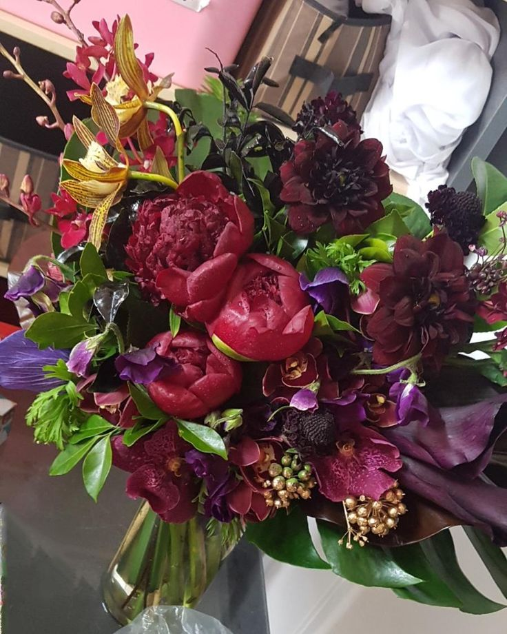 Winter Wedding Bride Bouquet - burgundy and purple tones. Peony rose, sweet pea, chocolate cosmos, carnations, orchids.