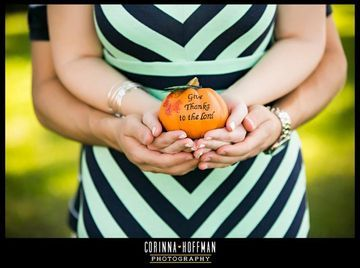 """Having a BFF who's a photographer has its perks, especially when it comes to capturing a pregnancy announcement photo. Lori Butler found this out firsthand when she and husband Jason askedphotog Corinna Hoffmanto do the honors. The couple knew what they wanted in the announcement photo: something gender neutral; something that echoed the best of fall, Lori's favorite season; and something that played off of """"little pumpkin,"""" their nickname for the baby. With Corinna's help, they achi"""