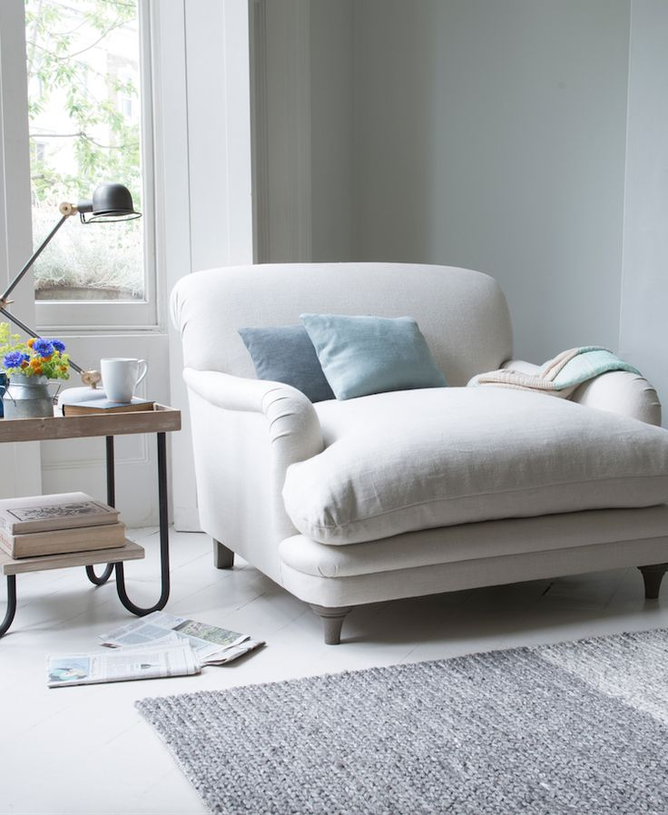Loaf's  comfy Pudding love seat in a natural Oat brushed cotton with light blue scatter cushions