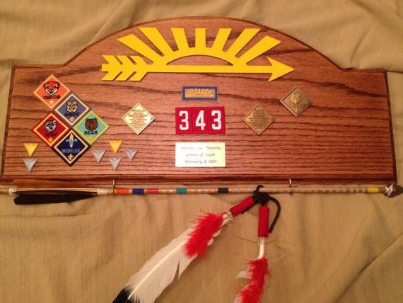 Cub Scout Arrow of Light Award Plaque - easy to cut the shape out & stain. Die cut arrow available? hmm.