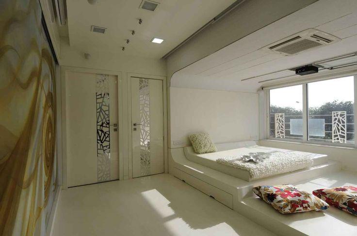 Bedroom-Enormous glass windows allow optimum sunlight and air.