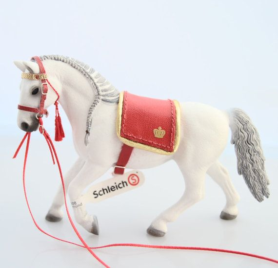 The horse shown in the photos is NOT included!    This hand made decorative red dressage tack with long reins for Schleich model horses contains:    -