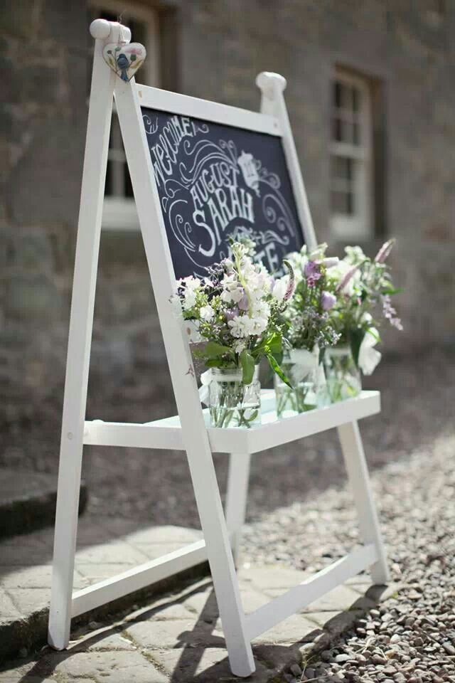 chalkboard easel i bought from ikea for welcome sign at shower. like the mason jars on it too!!