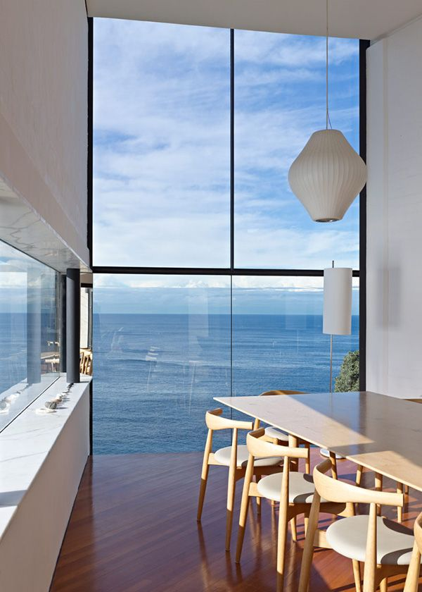 Low dining chairs -- clean view. Modern House Designs - Cliff House Architecture Inspired by Modern Picasso Art