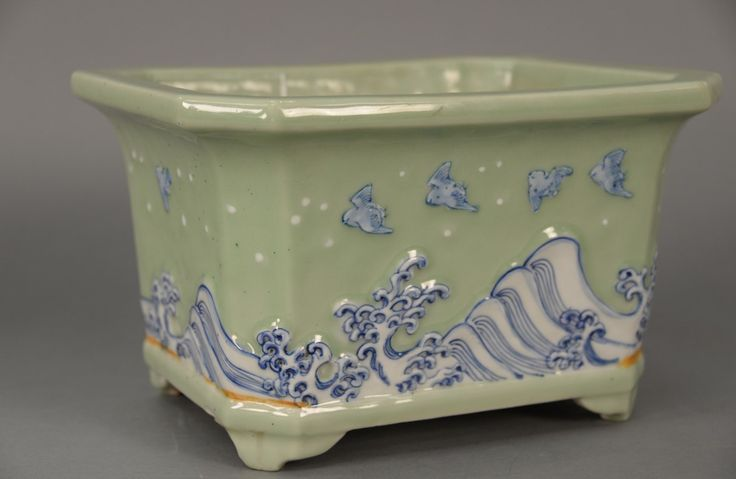 Celadon planter, rectangular, decorated with waves and birds.