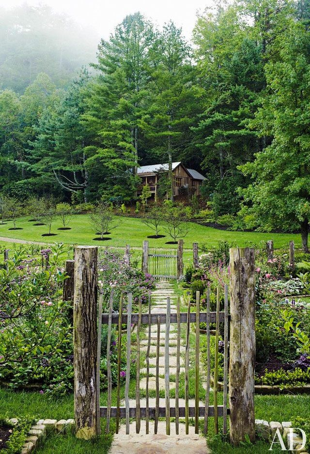 The cutting garden at a Tennessee compound is filled with both perennials and annuals; it was designed by landscape architect Mary Palmer Dargan. Beyond it are a newly planted apple orchard and, nestled at the edge of the woods, the Writer's Cottage.