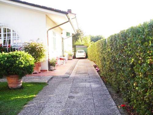 Car entrance to the villa, parking and garden