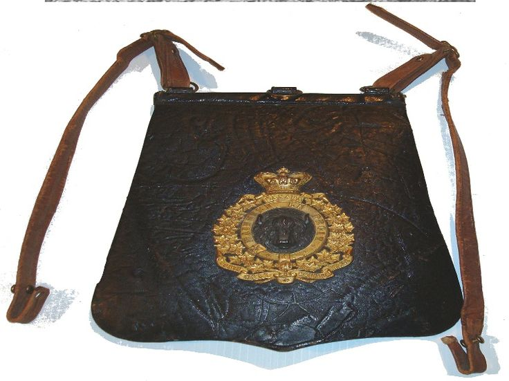 The sabretache was only worn in mounted order both in undress and full dress. It is black leather having a gilt badge with a silver bison head in the middle.