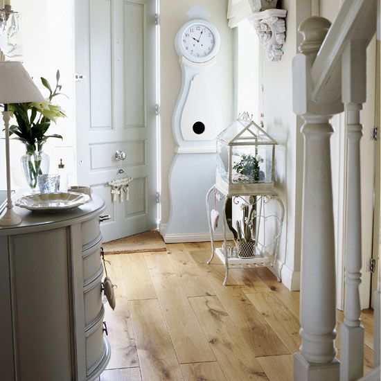 The beautiful wooden floor and Mora grandfather clock are the stars of this simple hallway
