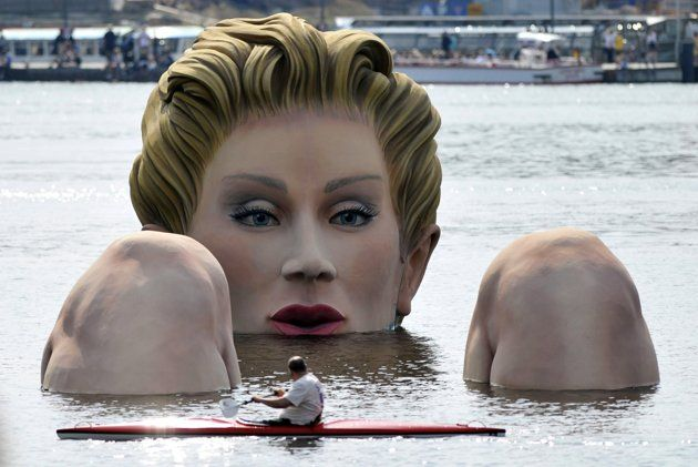 A giant statue of a lady in Hamburg, Germany can be seen floating at Alster Lake.