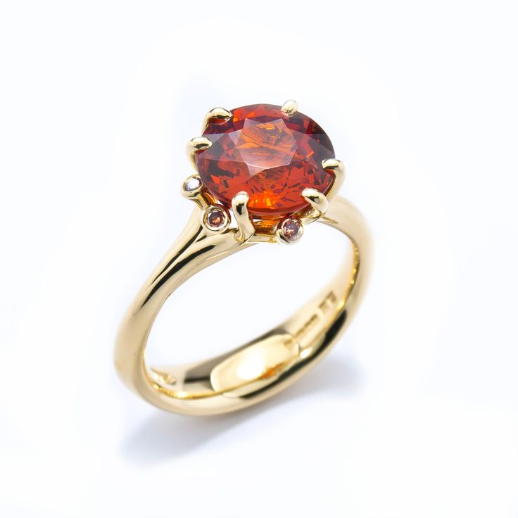 Summer Meadow ring set with spessatite garnet and brown diamonds in Fairtrade 18ct yellow gold #JonDibben #Fairtradegold #Fairtrade #garnet