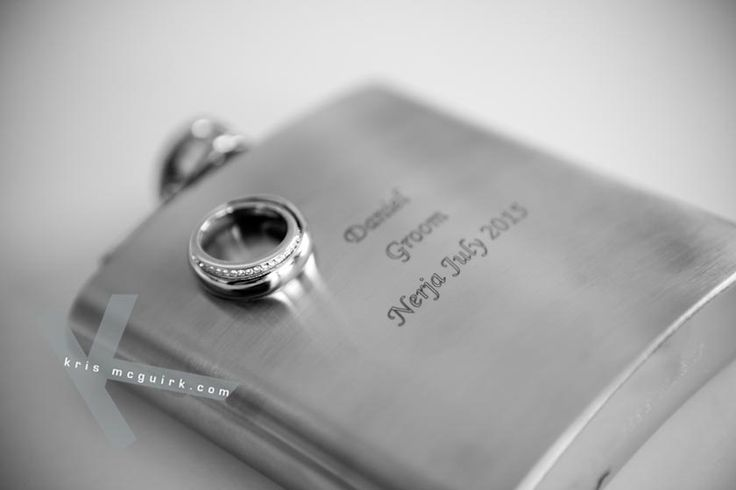 An engraved flask for the groom with wedding date. Destination wedding photography by Kris Mcguirk.