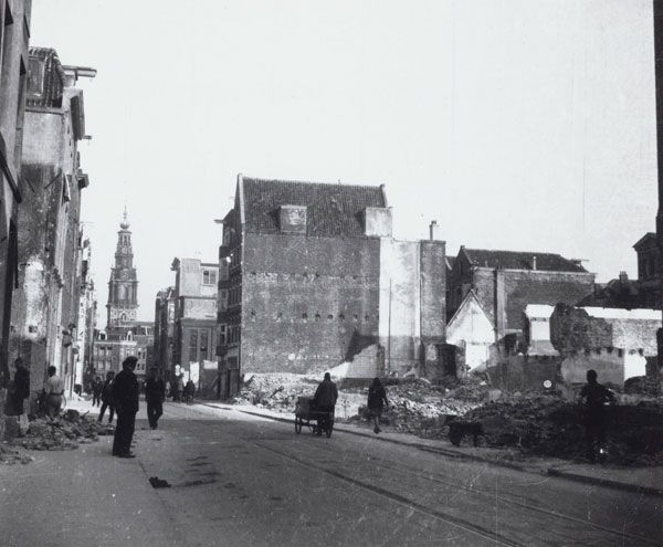 """1944. Few Jews from the so-called """"Jewish Corner"""" in Amsterdam escaped deportation to the extermination camps. Their houses generally remained empty. The citizens of Amsterdam stripped their homes. The wood was used for the fire place or stove. In the photo the Jodenbreestraat. #amsterdam #wordwar2"""