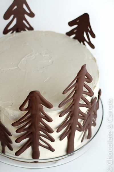 A great idea to decorate your cake. Draw your trees (or any design) on parchment or foil, place in fridge to harden, dab some extra chocolate on back to stick to cake. So simple so pretty