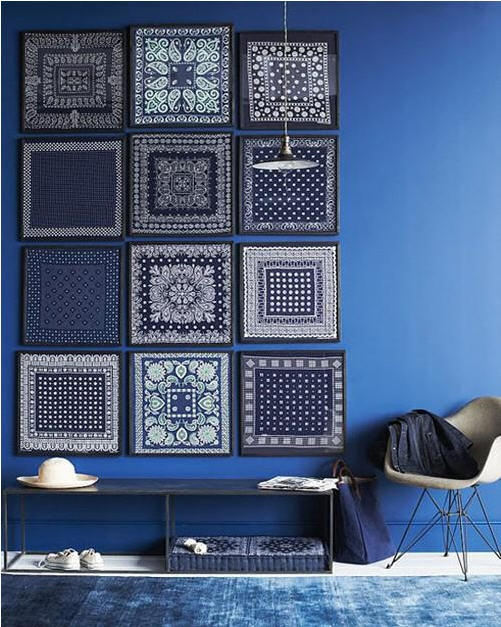 Indigo painted walls and wall decor with MCM shell chair (interesting mix)