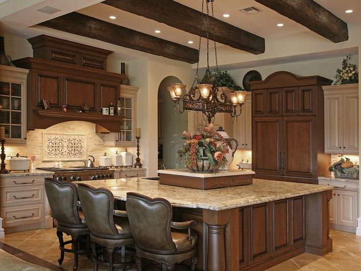Large dark wood island, white cabinets, dark wood stove hood. Lovely!