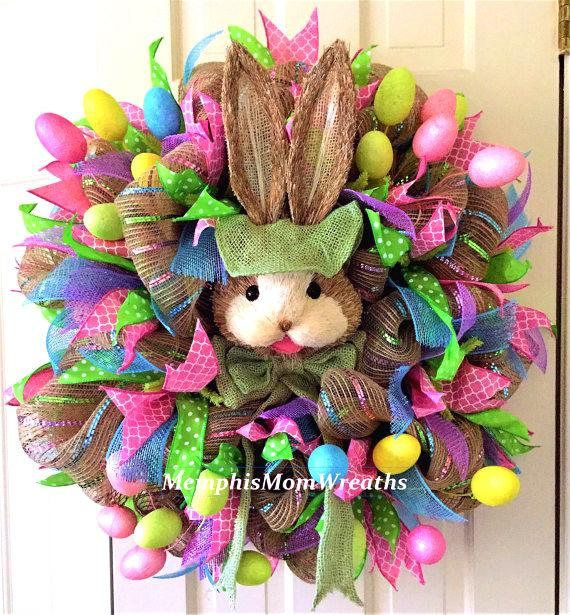 Its almost time for the Easter Bunny to hippity hop our way, and this gorgeous Easter Bunny Deco Mesh Wreath is the perfect way to welcome the Easter season. This 26 diameter wreath features 21 burlap mesh with metallic pastel pink, blue, and green stripes atop a spring green