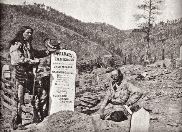 Colorado Charlie Utter (at right) and Arapaho Joe add a headstone to Wild Bill Hickok's Deadwood grave in 1877. Two years later, Hickok was reinterred at Mount Moriah Cemetery, where his grave mates became Calamity Jane, in 1903, and Potato Creek Johnny, in 1943.  –Courtesy Deadwood Public Library –