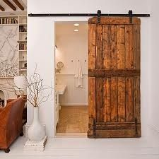 Fan-stinking tastic! I fell in love with the rustic look of these sliding reclaimed doors. I MUST have them in my house.