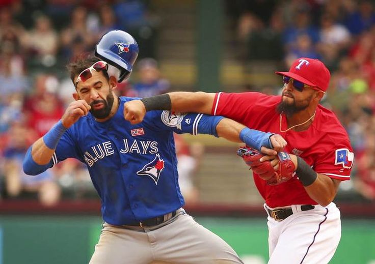 Toronto Blue Jays Jose Bautista (19) gets hit by Texas Rangers second baseman…
