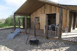 Camping in Zeeland - Strandpark De Zeeuwse Kust. Camping in a beach lodge in Holland
