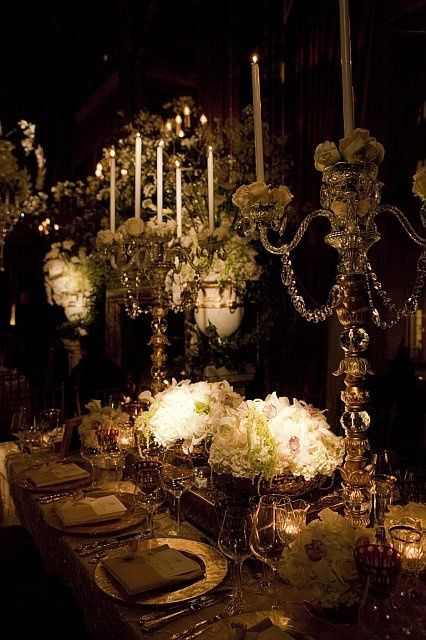 I noticed for the first time that it was the only chair at that great table, and there was only one place laid, although the table gleamed to its farther end with the curved backs of plate covers, and with goblets and tureens and tall jeweled pitchers.