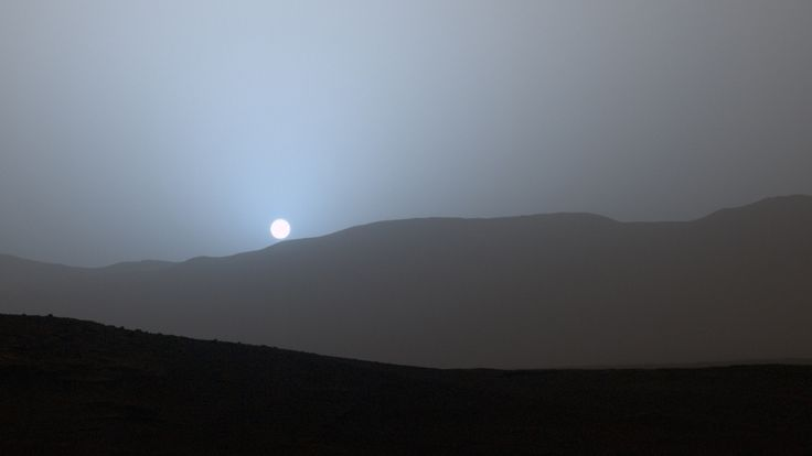 """from NASA: """"The sun dips to a Martian horizon in a blue-tinged sky in images sent home to Earth this week from NASA's Curiosity Mars rover."""""""