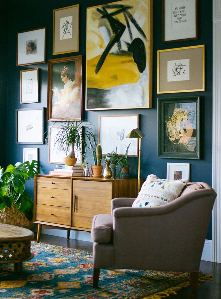 5 easy steps to hanging a wall of art like dabito living room blue credenza console bar blue art gallery wall - Galley Bedroom Decorating