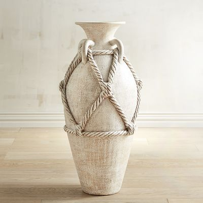 The classical accent you've been looking for is sublimely handcrafted in terracotta with sculpted rope accents and a beautiful timeless silhouette. Set this stunner alone in a hallway or entryway or add carefully selected faux florals or stems.